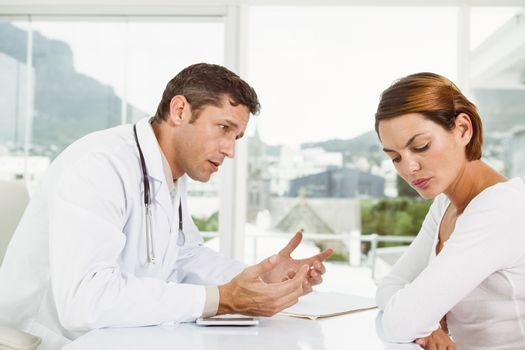Doctor in discussion with patient in medical office