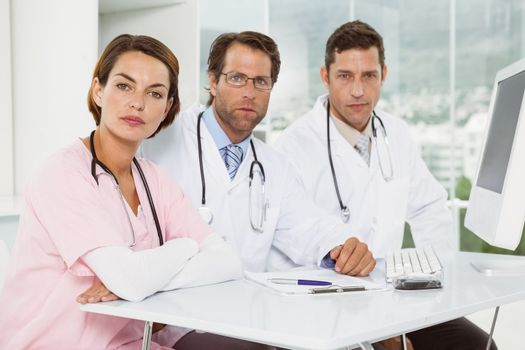 Confident doctors at medical office