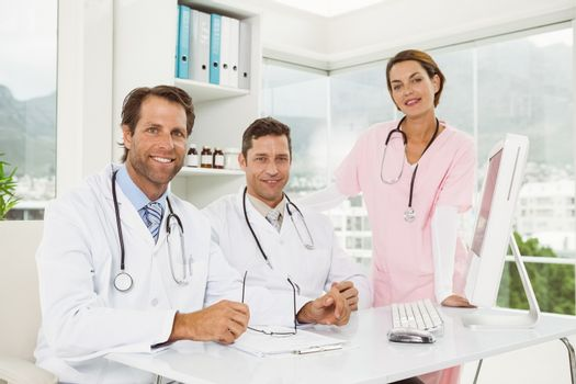 Confident doctors smiling at medical office
