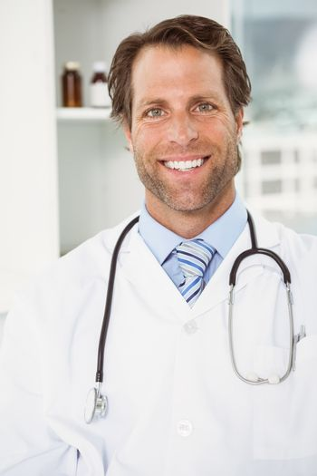 Smiling male doctor in medical office
