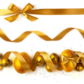 Easter egg composition with golden ribbon isolated on white background stripe line design element