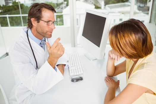 Doctor in discussion with patient at medical office