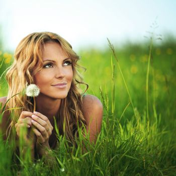 Girl with dandelion on spring meadow i wish concept