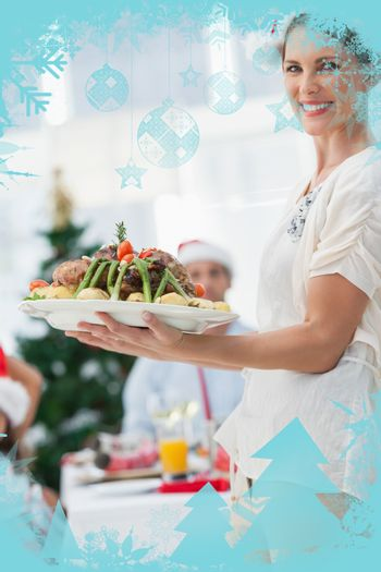 Attractive woman bringing roast chicken at a christmas dinner against christmas frame
