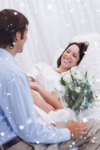 Woman is happy about receiving a visit at the hospital