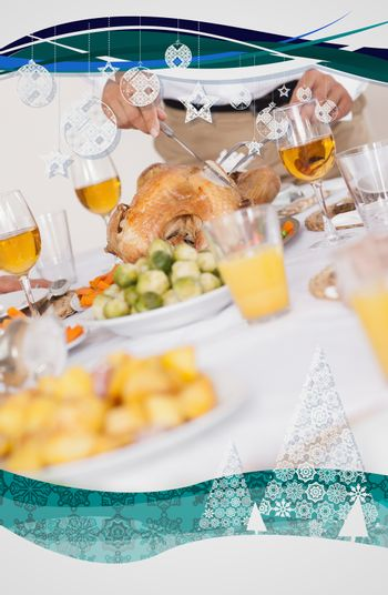 Turkey being carved at dinner table