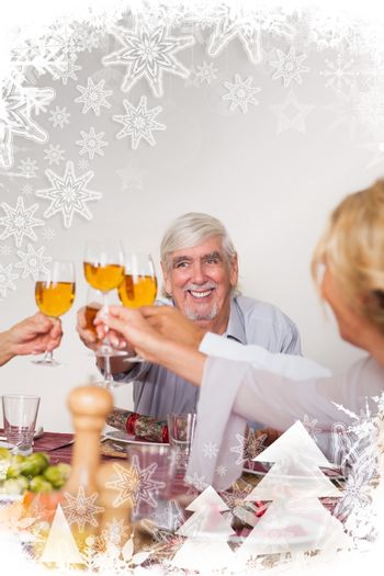 Family toasting each other at christmas