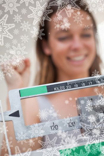 Scale showing dieting success for woman
