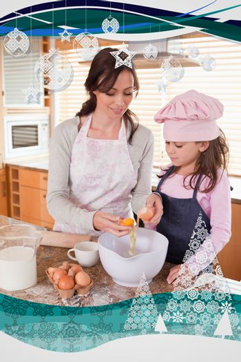 Happy mother and her daughter baking