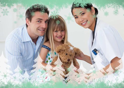 Portrait of a doctor and happy little girl examing a teddy bear against green snowflake design