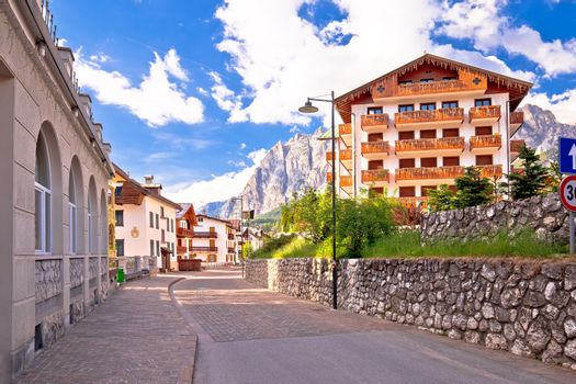 Cortina D' Ampezzo street and Alps peaks view