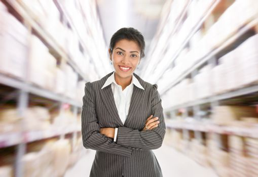 Business woman standing at warehouse.