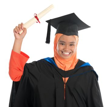 Female student in graduation gown, standing isolated white background.