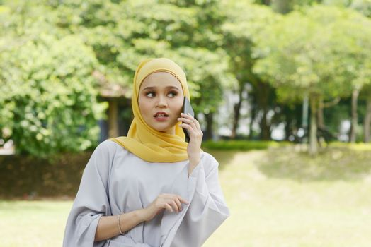 Muslim women received scam call, phishing alert concept.