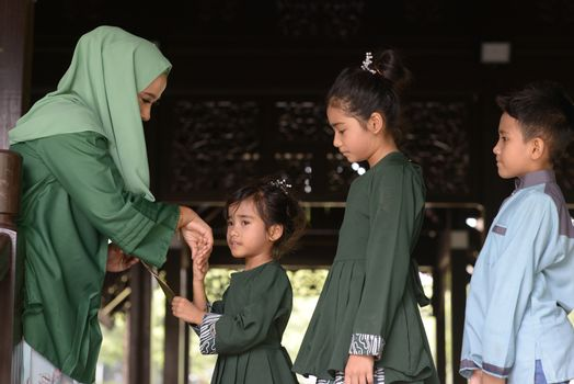 Muslim family greeting, Hari Raya Eid Al-Fitr concept.