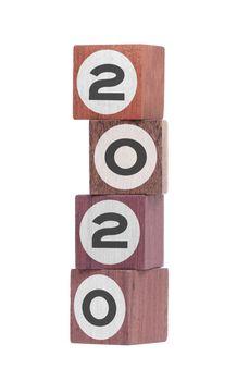 Four isolated hardwood toy blocks, saying 2020