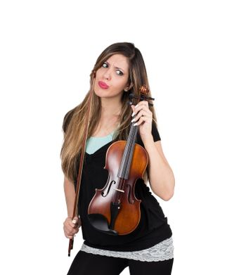 perplexed girl with her violin