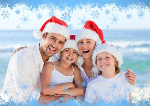 Family during Christmas day at the beach against snow flake frame in blue