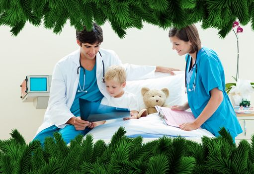 Attractive doctor showing an xray to his patient against fir tree branches forming frame