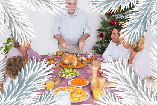 Composite image of grandfather carving the turkey
