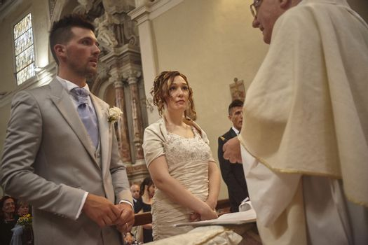 Newlyweds during the church ceremony in a catholic church