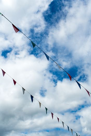 Triangle flag hanging on the rope and blue sky