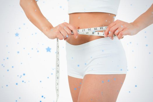 Feminine body with a measuring tape