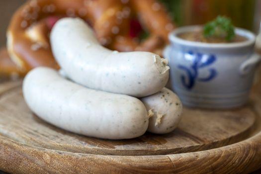 three bavarian white sausages with mustard