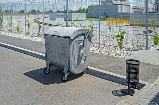 Item garbage collection and waste near the protected industrial zone.
