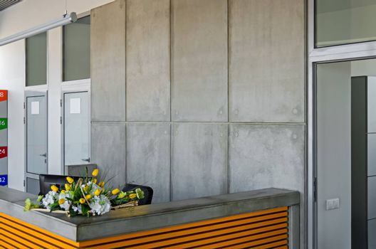 Gray-yellow modern counter on an internal entrance to metallurgical company.