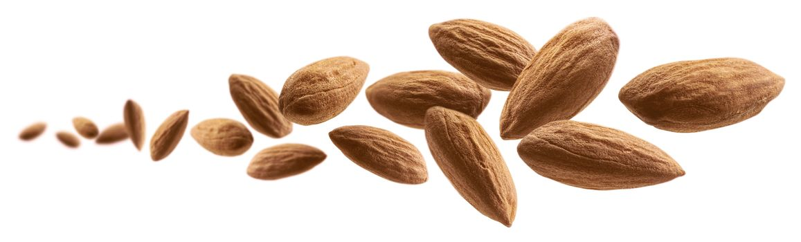 Almond nuts levitate on a white background.
