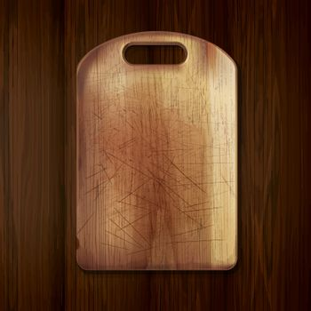 Wooden cutting board on a wooden table.