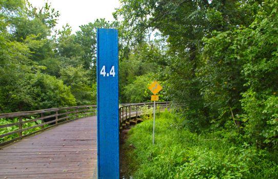 Four Point Four Marker Before Bridge on a Rural Runnint Trail