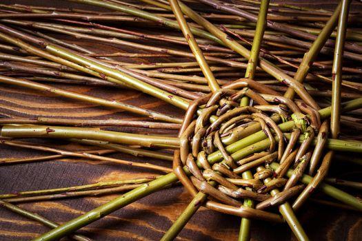 detail of starting to knit wicker basket