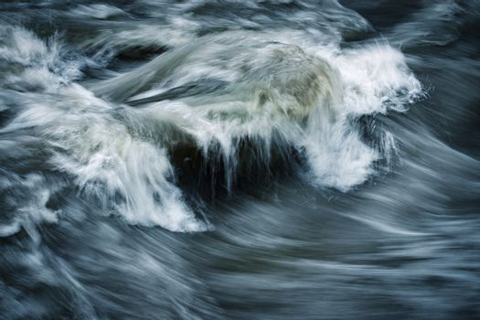 dramatic atmosphere on a dark wild river