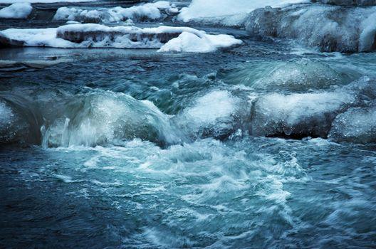Cascade on the frozen river wild