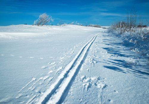 snowy plain with a ski track