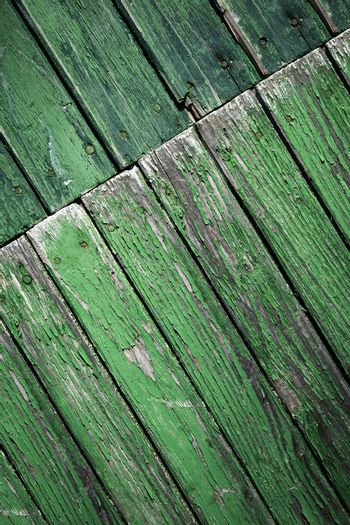 oblique turned old green wooden paneling