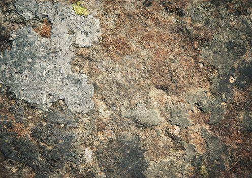 dark sandstone surface with moss