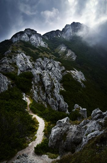 dark clouds above the limestone mountains