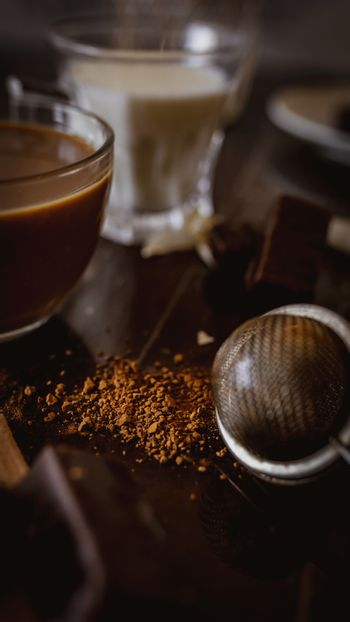 Cup of hot cappuccino with cocoa powder with chocolate