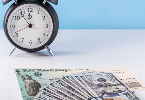 Illustration of missing federal stimulus payment check with cash and alarm clock