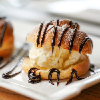 Profiterole, a filled French choux pastry ball with a typically sweet and moist filled