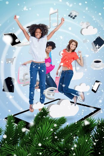 Composite image of a Three cute women jumping on a tablet pc against snow falling