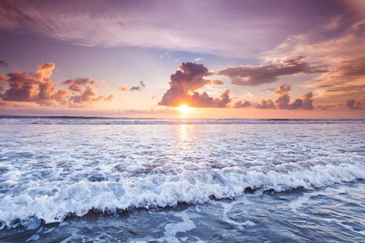 Amazing sunset from Bali Double Six beach surf waves and colorful clouds