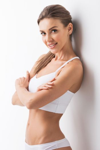 Portrait of beautiful woman in cotton undrewear posing with arms crossed