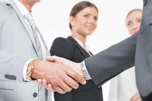 Business handshake of business people team on white