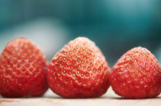 Tasty strawberries in turn