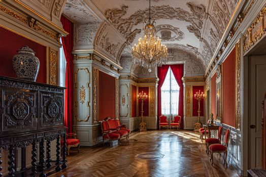 Interiors of royal halls in Christiansborg Palace in Copenhagen Denmark, corridor with antique furniture and paintings