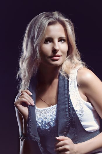 young, girl, blonde, jeans, clothes on a dark background